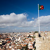 The Portuguese flag fluttering over Lisbon on Saint George castle