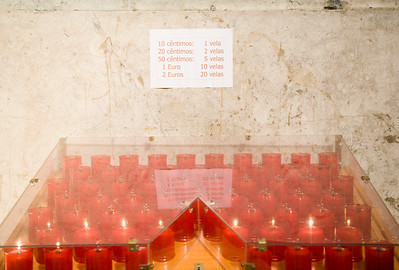 Electric candles with their prices, Graça church, Lisbon, Portugal