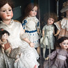 Vintage porcelain dolls exposed on a shop window, Calçada do Combro, Lisbon