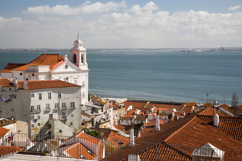 View of Lisbon from Santa Luzia viewpoint, with Santo Estevao church on the left.