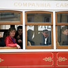 Passengers looking through the window of a city tram, Lisbon