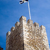 The Lisbon flag fluttering on the top of Saint George castle