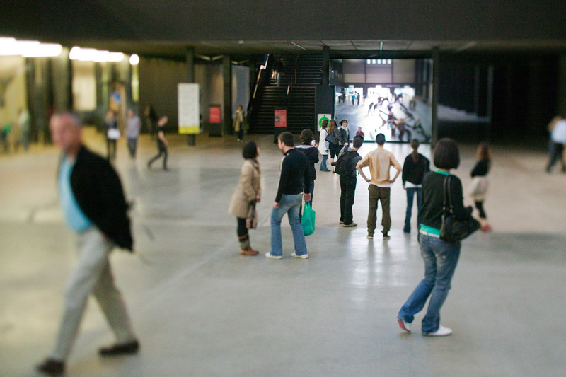Visitors watching themselves on a huge screen, Turbine Hall, Tate Modern, London, England, United Kingdom
