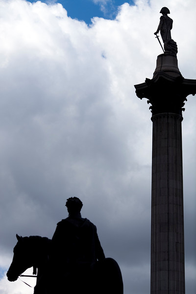 Statue and George IV and Nelson's column on the background, Trafalgar square, London, England, United Kingdom