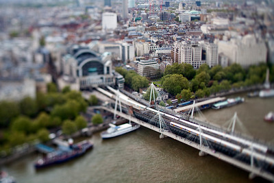 Aerial view of Hungerford bridge over the Thames and Charing Cross station, London, England, United Kingdom.Tilted lens used for shallow depth of field.