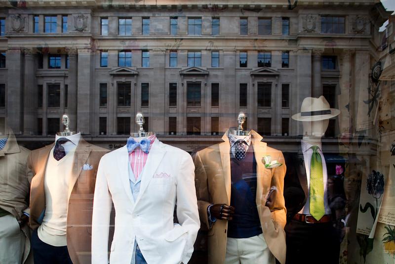 Reflections on a boutique shop window, Regent street, Westminster, London, England, United Kingdom
