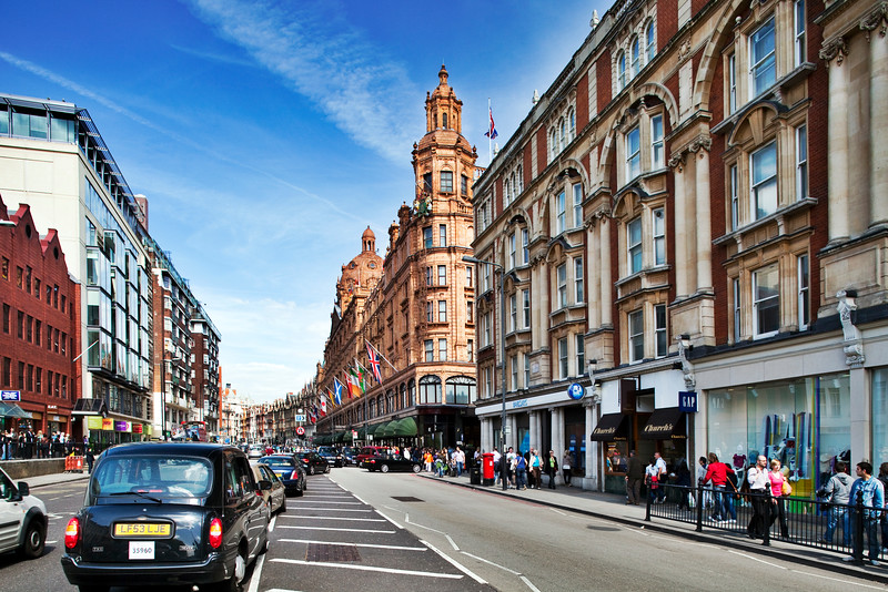 Perspective of Brompton Road with Harrods building on the right side. London, England, United Kingdom
