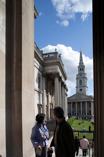 Visitors looking at Saint Martin in the Fields church from the National Gallery entrance, London, England, United Kingdom