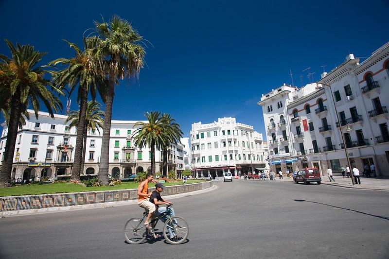 Kids riding a bike, Hassan II square, Tetouan, Morocco