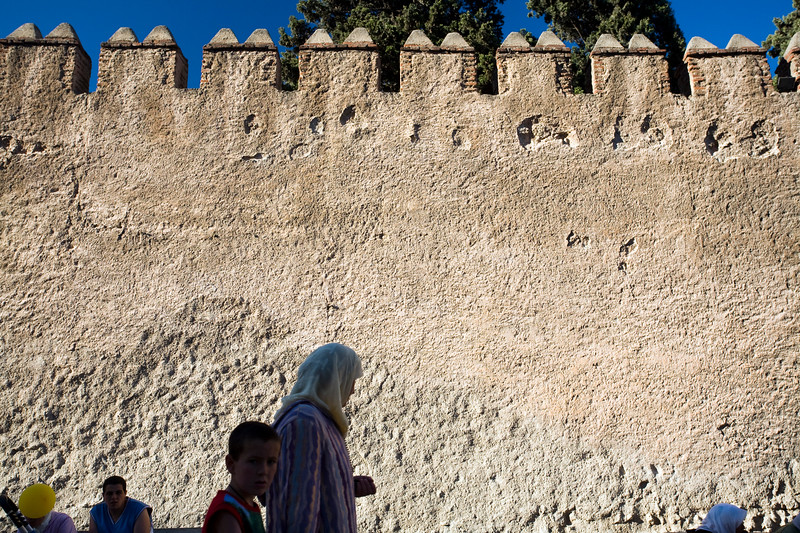 People walking by the medieval city walls, town of Tetouan, northern Morocco, Africa