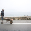 Construction worker with a wheelbarrow, Morocco