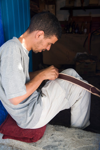 Leather artisan at work, Chefchaouen, Morocco
