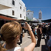 Western tourist taking pictures in the medina, Tetouan, Morocco
