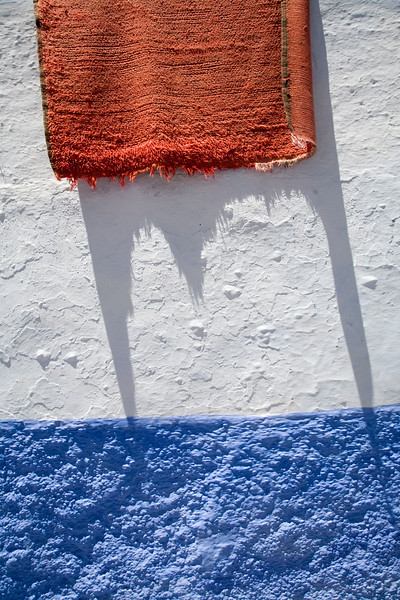 Carpet on a whitewashed wall, Chefchaouen, Morocco