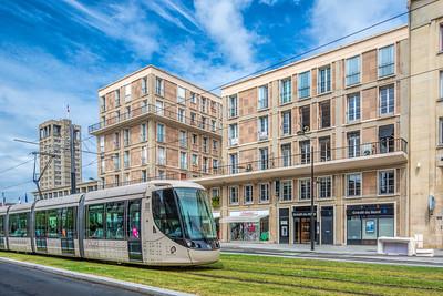 Tram on Boulevard de Strasbourg,  (the City Hall tower on the left), Le Havre, France