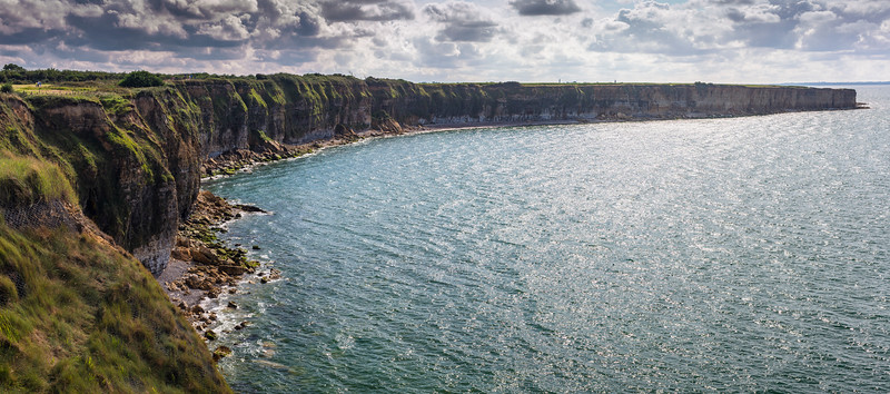 Panoramic view of Pointe du Hoc Cliff. Pointe du Hoc s a promontory with a 100 ft (30 m) cliff overlooking the English Channel on the coast of Normandy in northern France. During World War II it was the highest point between Utah Beach to the west and Omaha Beach to the east. The German army fortified the area with concrete casemates and gun pits. On D-Day (6 June 1944) the United States Army Ranger Assault Group assaulted and captured Pointe du Hoc after scaling the cliffs.