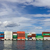 Piles of container on the docks of Oslo seaport. Taken from a boat.