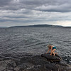 Lonesome woman at the beach, Bygdoy peninsula, Oslo, Norway.