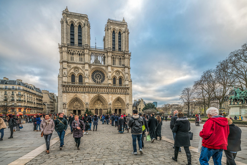 Visitors in front of Notre Dame cathedral, Paris, France