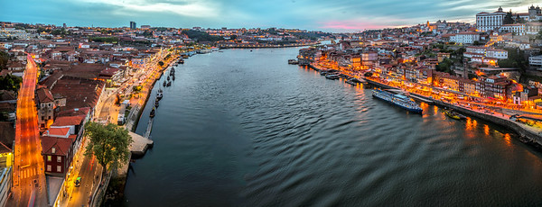 Panoramic view of the Douro river and the city of Porto (right bank) and Vilanova de Gaia (left bank) from Dom Luis I bridge, Portugal.