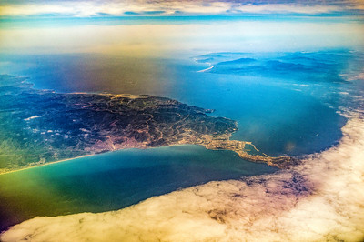 Africa (left, with the Spanish port of Ceuta and the Moroccan city of Castillejos or Fndeq) Europe (right) and the Gibraltar Strait in the middle as seen from a flying airplane.