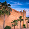 Walls of the Kasbah. The Kasbah of the Udayas is a kasbah in Rabat, Morocco at the mouth of the Bou Regreg river opposite Salé. It was built during the reign of the Almohads (AD 1121-1269). It was granted World Heritage Status in 2012.
