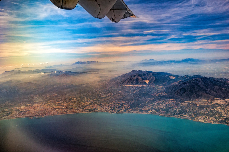 View of Malaga and Costa del Sol shore from a flying airplane
