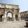 The arch of Constantine with the Colosseum on the background