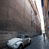 Volkswagen beetle on a narrow Roman street