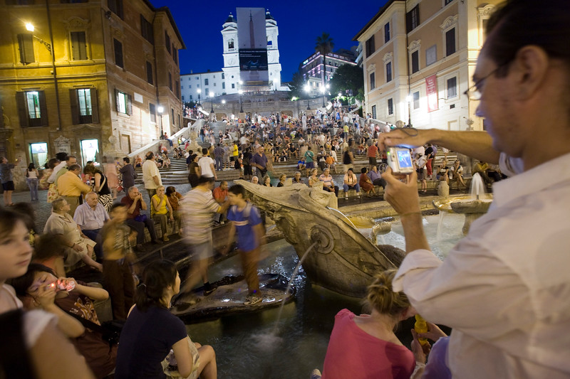 Tourist taking pictures at Spanish steps, Rome