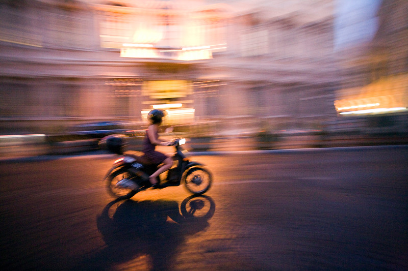 Panning shot of typical Roman scooter