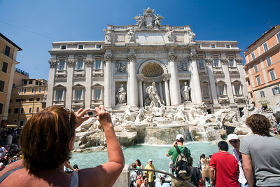 Visitors taking pictures of Trevi fountain, Rome