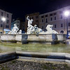 Nocturnal view of Neptune fountain at Navona square, Rome