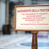Sign with the timetable of penances, Saint Peter's basilica, Vatican