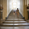 Mother and daughter climbing the stairs of the Doria Pamphili Gallery, Rome