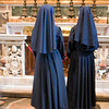Couple of nuns admiring the body of the pope John XXIII, Saint Peters basilica, Vatican