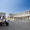A couple riding a scooter on Piazza della Repubblica, Rome