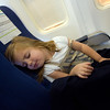 A child sleeping on her airplane seat during a fly