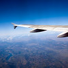 The wing of an Airbus plane flying over Spain