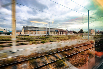 View through the window of a TGV train approaching Paris, France