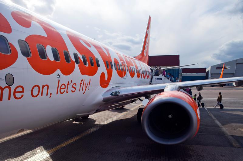 Passengers boading an EasyJet plane, Luton Airport, UK