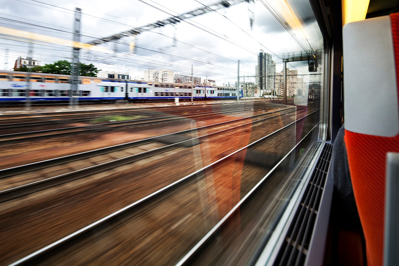 View through the window of a TGV train approaching Paris, France