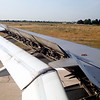 Wing of a plane at landing on Orly airport, Paris