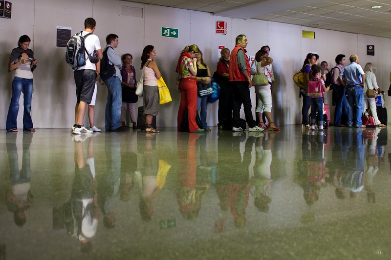 Line of passengers waiting for boarding, Malaga airport, Andalusia, Spain