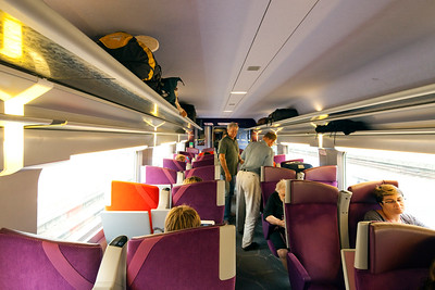 People inside a TGV train near Paris, France