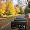 Post Boxes in a fall scene, Wilton, CT, USA.