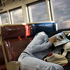 Girl trying to get asleep on a train, NYC, USA