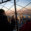 Visitors admiring NYC from the Empire State Building