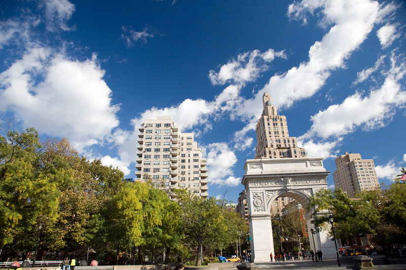 Northward view of Wahsington Square Arch and Park with the 5th Avenue on the background, NYC, USA.