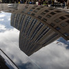 The Empire State Building reflected on the top of a car, NYC